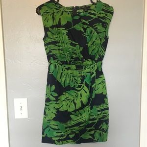 Green and navy palm print faux wrap dress.